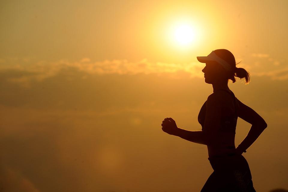 Runner against a sunset