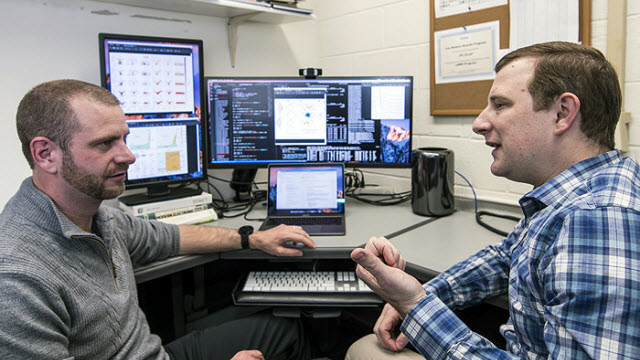 March 26, 2018 Marc Janoschek, left, and David Fobes discuss features of quantum materials. Marc Janoschek, left, and David Fobes discuss features of quantum materials