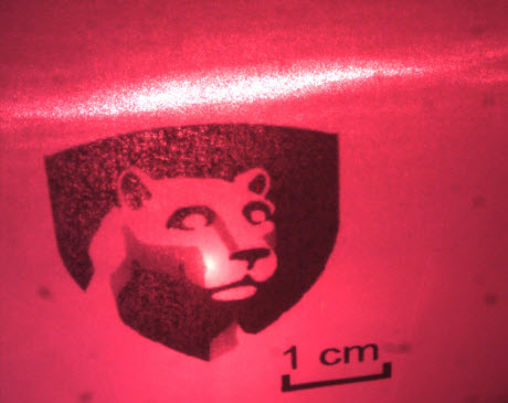 red laser beam shining on Penn State logo