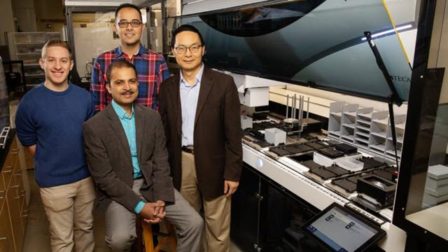 Scott Weisberg, left, professor Saurabh Sinha, seated, Mohammad (Sam) Hamedi Rad, and professor Huimin Zhao