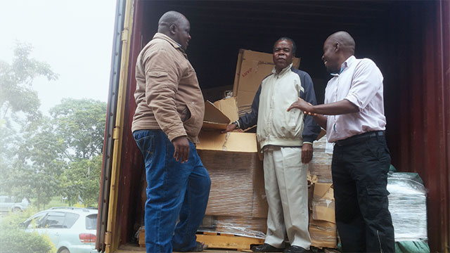 Dr. John Muoma and lab shipment
